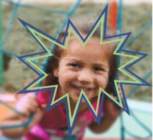 A young girl is playing on a jungle gym net. She is very blurry appearing and there are blue and green zigzag shapes around her face.